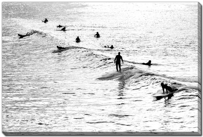 silhouette surfers